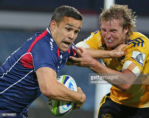 Tamati Ellison of the Rebels is tackled by Hadleigh Parkes of the Hurricanes during the Super Rugby trial match between the Rebels and the Hurricanes...