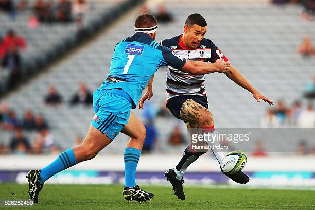 Tamati Ellison of the Rebels kicks the ball through during the Super Rugby round ten match between the Blues and the Melbourne Rebels at Eden Park on...