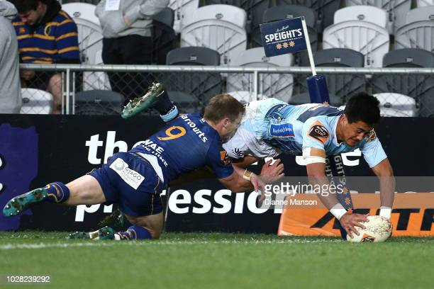 Tamati Tua of Northland dives over to score a try during the round four Mitre 10 Cup match between Otago and Northland at Forsyth Barr Stadium on...