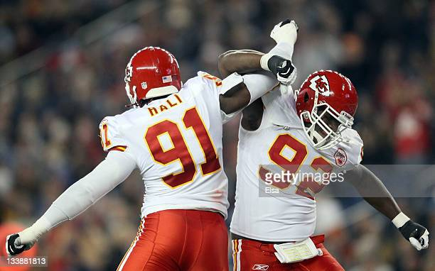 Tamba Hali and Wallace Gilberry of the Kansas City Chiefs celebrate a sack of New England Patriots quarterback Tom Brady in the second quarter on...