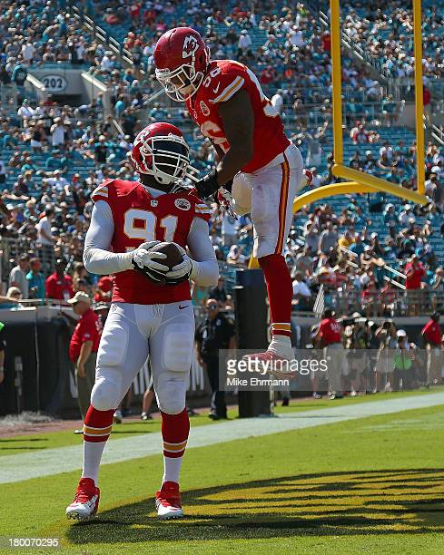 Tamba Hali of the Kansas City Chiefs celebrates a touchdown during a game against the Jacksonville Jaguars at EverBank Field on September 8 2013 in...
