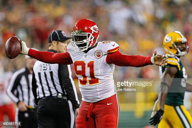Tamba Hali of the Kansas City Chiefs celebrates after making a tackle against the Green Bay Packers in the first half at Lambeau Field on September...