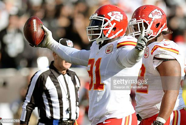 Tamba Hali of the Kansas City Chiefs celebrates after recovering a fumble against the Oakland Raiders during the second quarter at Oco Coliseum on...