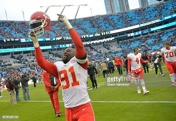 Tamba Hali of the Kansas City Chiefs celebrates as he leaves the field after a win against the Carolina Panthers at Bank of America Stadium on...