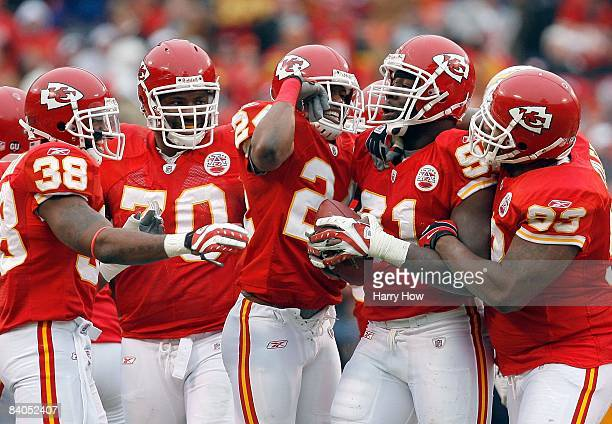 Tamba Hali of the Kansas City Chiefs celebrates his fumble recovery with Brandon Flowers Tank Tyler Alfonso Boone and DaJuan Morgan against the San...