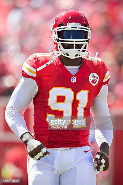 Tamba Hali of the Kansas City Chiefs runs onto the field before a game against the Tennessee Titans at Arrowhead Stadium on September 7, 2014 in...