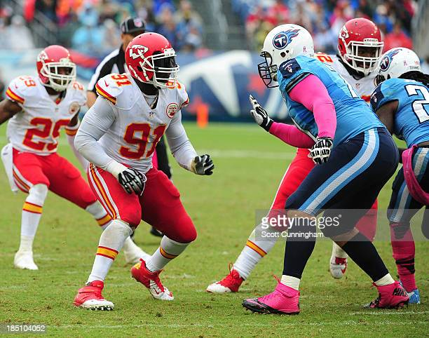 Tamba Hali of the Kansas City Chiefs rushes the passer against Michael Roos of the Tennessee Titans at LP Field on October 6 2013 in Nashville...