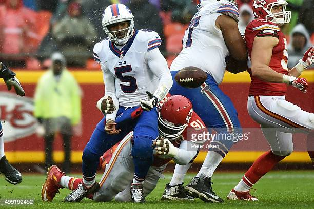 Tamba Hali of the Kansas City Chiefs sacks and forces a fumble on Tyrod Taylor of the Buffalo Bills at Arrowhead Stadium during the third quarter of...