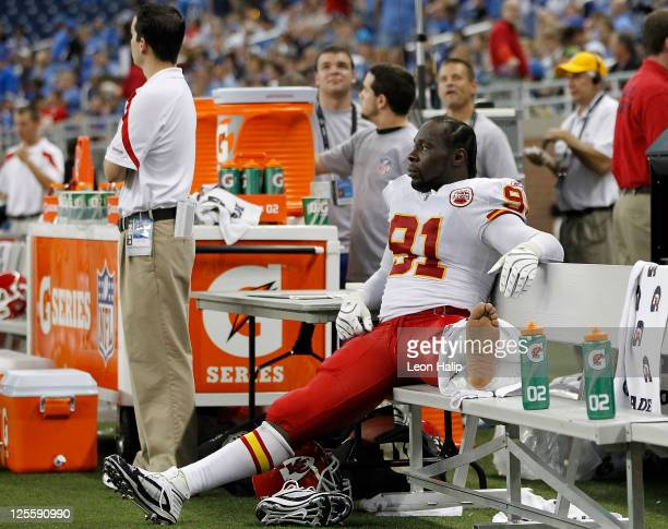 Tamba Hali of the Kansas City Chiefs watches the action from the bench after suffering a second half injury during the game against the Detroit Lions...