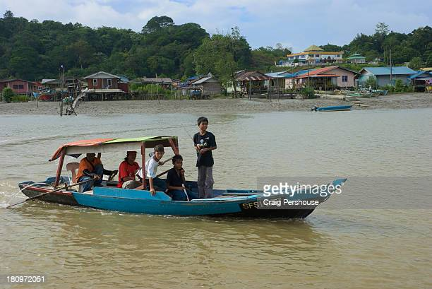 tambang (small river ferry) on the bako river - bako national park stock pictures, royalty-free photos & images