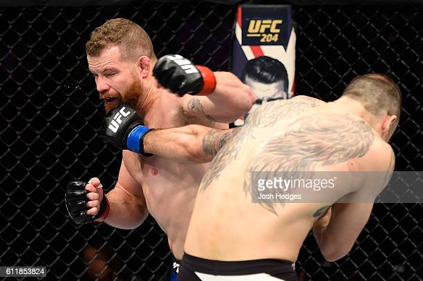 Tamdan McCrory punches Nate Marquardt in their middleweight bout during the UFC Fight Night event at the Moda Center on October 1 2016 in Portland...