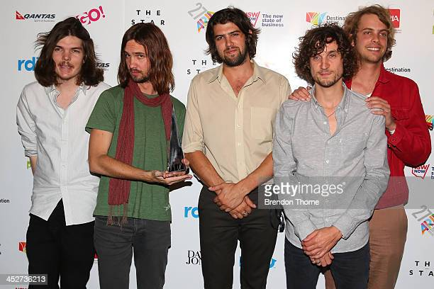 Tame Impala pose after winning the Best Group ARIA at the 27th Annual ARIA Awards 2013 at the Star on December 1 2013 in Sydney Australia