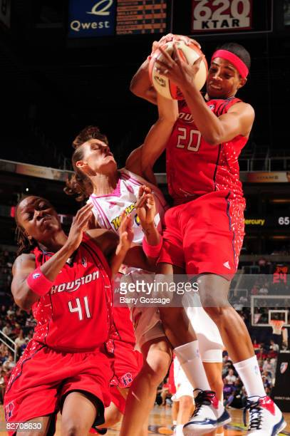 Tamecka Dixon of the Houston Comets grabs a rebound against Kelly Miller of the Phoenix Mercury on September 7 at US Airways Center in Phoenix...