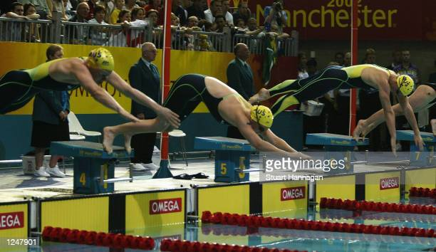 LR Tamee White Laisel Jones and Brooke Hanson of Australia at the start of the Women's 100M Breaststroke swimming Final from the Manchester Aquatics...