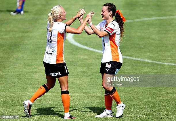 Tameka Butt and Hayley Raso of the Roar celebrate a goal during the round seven W-League match between the Newcastle Jets and the Brisbane Roar at...