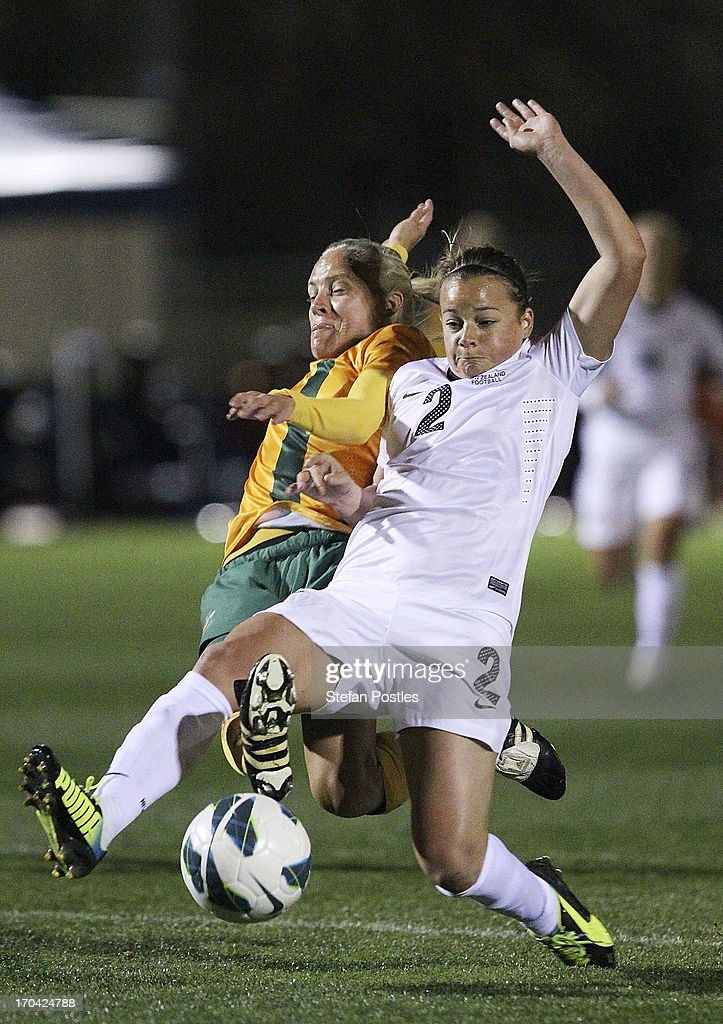 Tameka Butt of Australia and Ria Percival of New Zealand contest possession during game one of the Women's International Series between the Australian Matildas and the New Zealand Football Ferns at AIS on June 13, 2013 in Canberra, Australia.