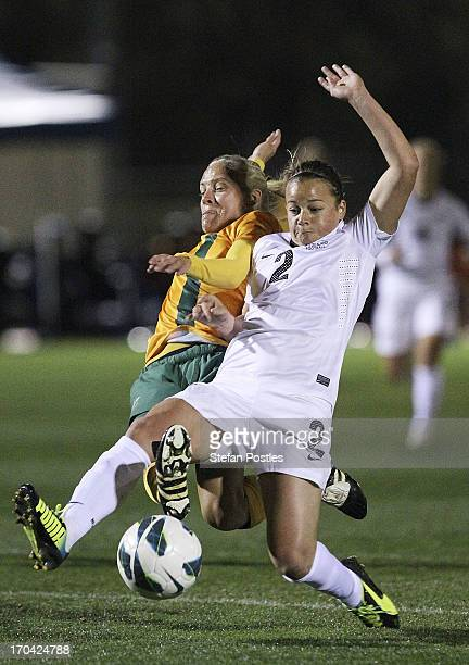 Tameka Butt of Australia and Ria Percival of New Zealand contest possession during game one of the Women's International Series between the...