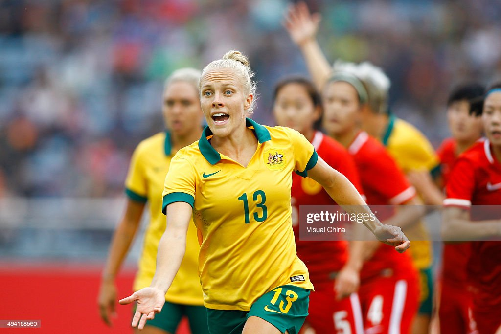 Tameka Butt #13 of Australia celebrates with team mates after scoring her team's first goal in the match between China and Australia during the 2015 Yongchuan Women's Football International Matches at Yongchuan Sports Center on October 25, 2015 in Yongchuan, Chongqing of China.