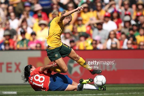 Tameka Butt of Australia is challenged by Camila Sáez of Chile during the International Friendly match between the Australian Matildas and Chile at...