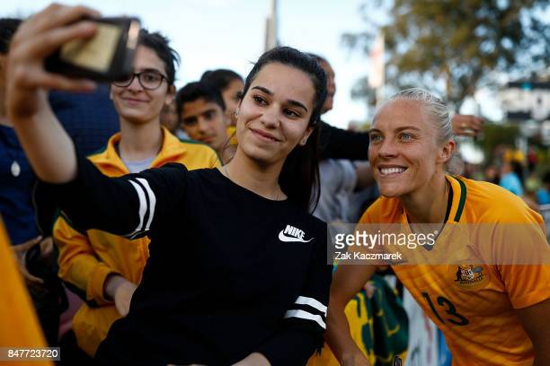 Tameka Butt of Australia poses with fans after the women's international match between the Australian Matildas and Brazil at Pepper Stadium on...