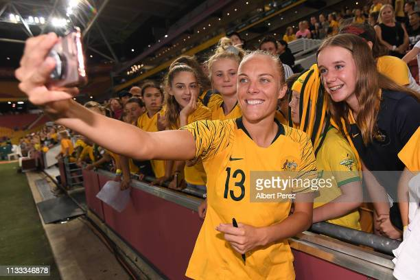 Tameka Butt of Australia takes selfies with fans after the 2019 Cup of Nations match between Australia and the Korea Republic at Suncorp Stadium on...