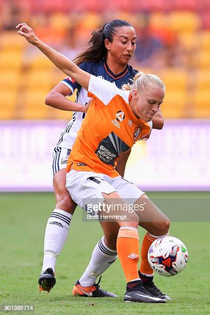 Tameka Butt of Brisbane and Gulcan Koca of Melbourne contest the ball during the round ten W-League match between the Brisbane Roar and Melbourne...