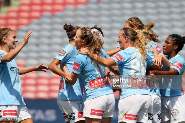 Tameka Butt of Melbourne City celebrates her goal with team mates during the round six W-League match between the Newcastle Jets and Melbourne City...