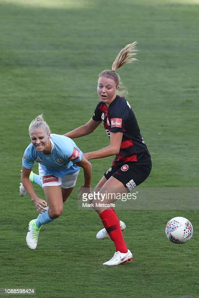 Tameka Butt of Melbourne City is tackled by Maruschka Waldus of the Wanderers during the round nine W-League match between the Western Sydney...