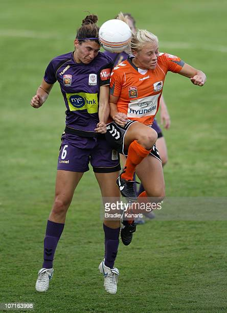 Tameka Butt of the Roar and Alexandra Singer of the Glory challenge for the ball during the round four W-League match between the Brisbane Roar and...