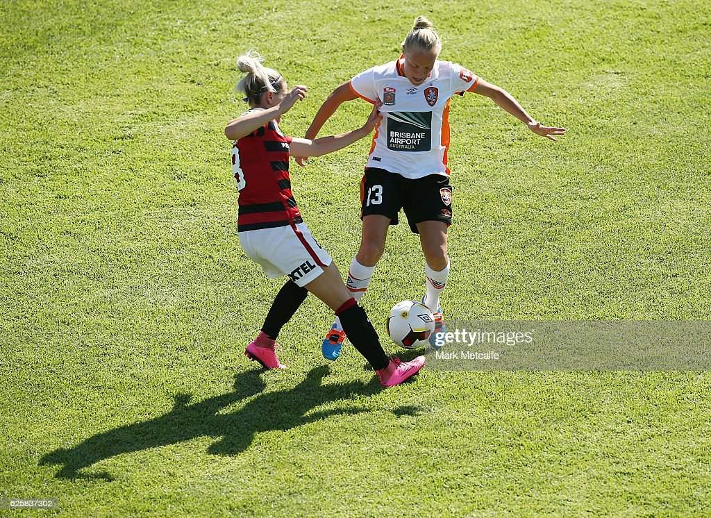 Tameka Butt of the Roar and Erica Halloway of the Wanderers compete for the ball during the round four W-League match between the Western Sydney Wanderers and the Brisbane Roar at Marconi Stadium on November 26, 2016 in Sydney, Australia.