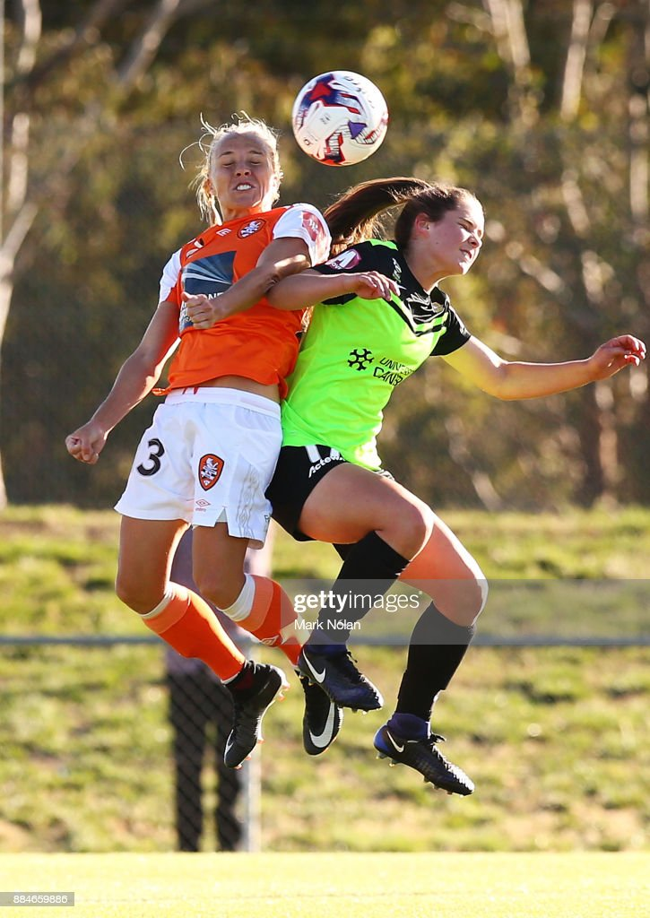 Tameka Butt of the Roar and Madelyn Whittall of Canberra contest possession during the round six W-League match between Canberra United and the Brisbane Roar at McKellar Park on December 3, 2017 in Canberra, Australia.