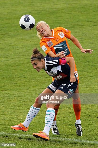 Tameka Butt of the Roar and Stephanie Catley of Victory contest the ball during the round 10 W-League match between Melbourne and Brisbane at...