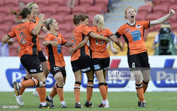 Tameka Butt of the Roar and team mates celebrate a goal during the round 10 WLeague match between the Brisbane Roar and the Western Sydney Wanderers...