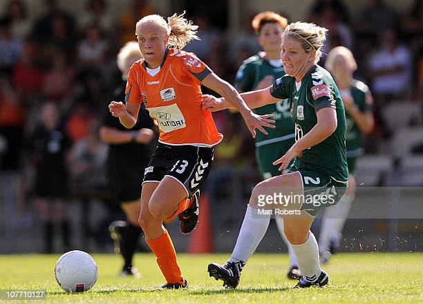 Tameka Butt of the Roar attempts to pass Caitlin Cooper of Canberra during the round six W-League match between the Brisbane Roar and Canberra United...