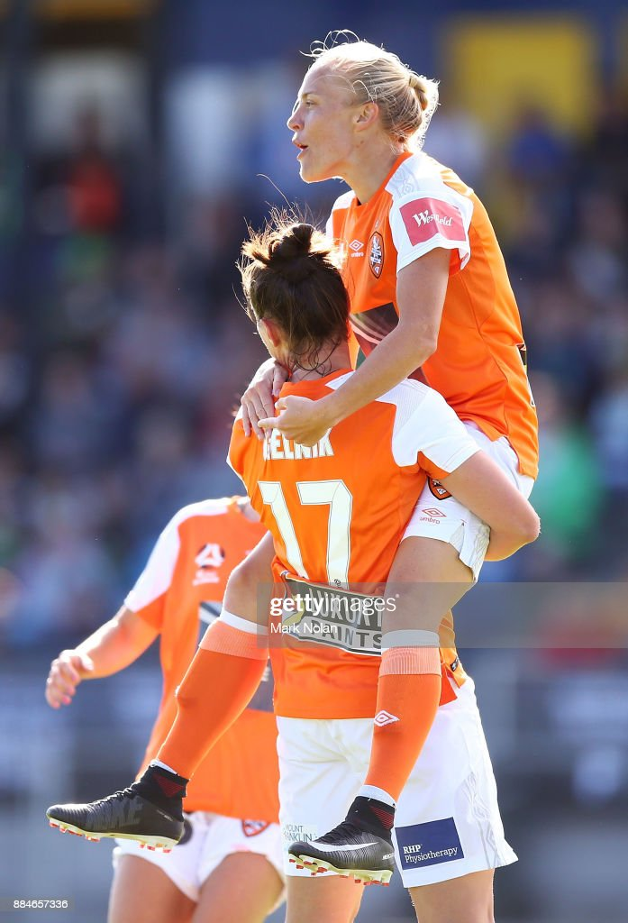 Tameka Butt of the Roar celebrates scoring a goal with team mates during the round six W-League match between Canberra United and the Brisbane Roar at McKellar Park on December 3, 2017 in Canberra, Australia.