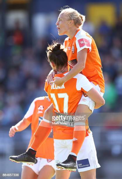 Tameka Butt of the Roar celebrates scoring a goal with team mates during the round six WLeague match between Canberra United and the Brisbane Roar at...