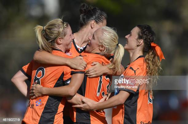Tameka Butt of the Roar celebrates with team mates after scoring a goal during the round eight W-League match between the Brisbane Roar and the Perth...
