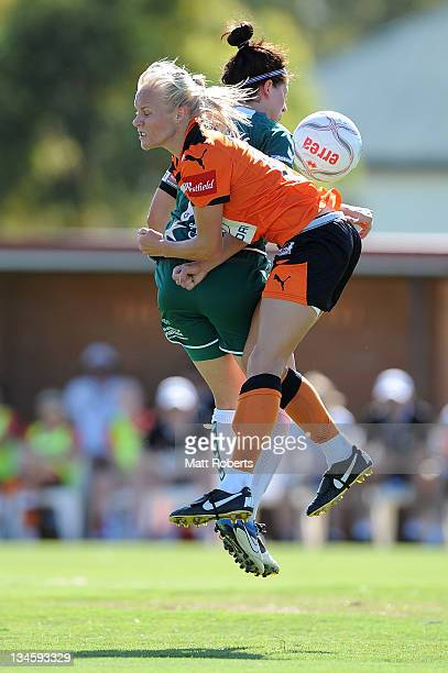 Tameka Butt of the Roar contests for the ball with Ellie Brush of United during the round seven W-League match between the Brisbane Roar and Canberra...