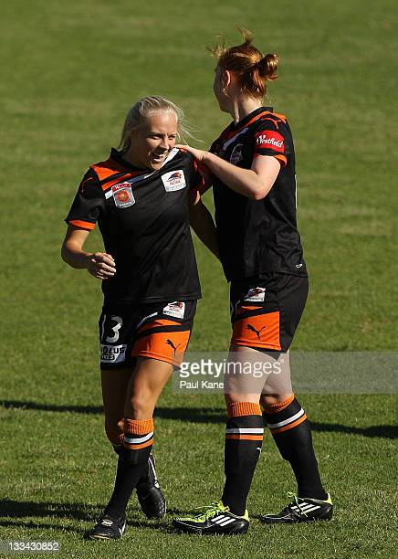 Tameka Butt of the Roar is congratulated by Ashley Spina after scoring a goal during the round five WLeague match between the Perth Glory and the...