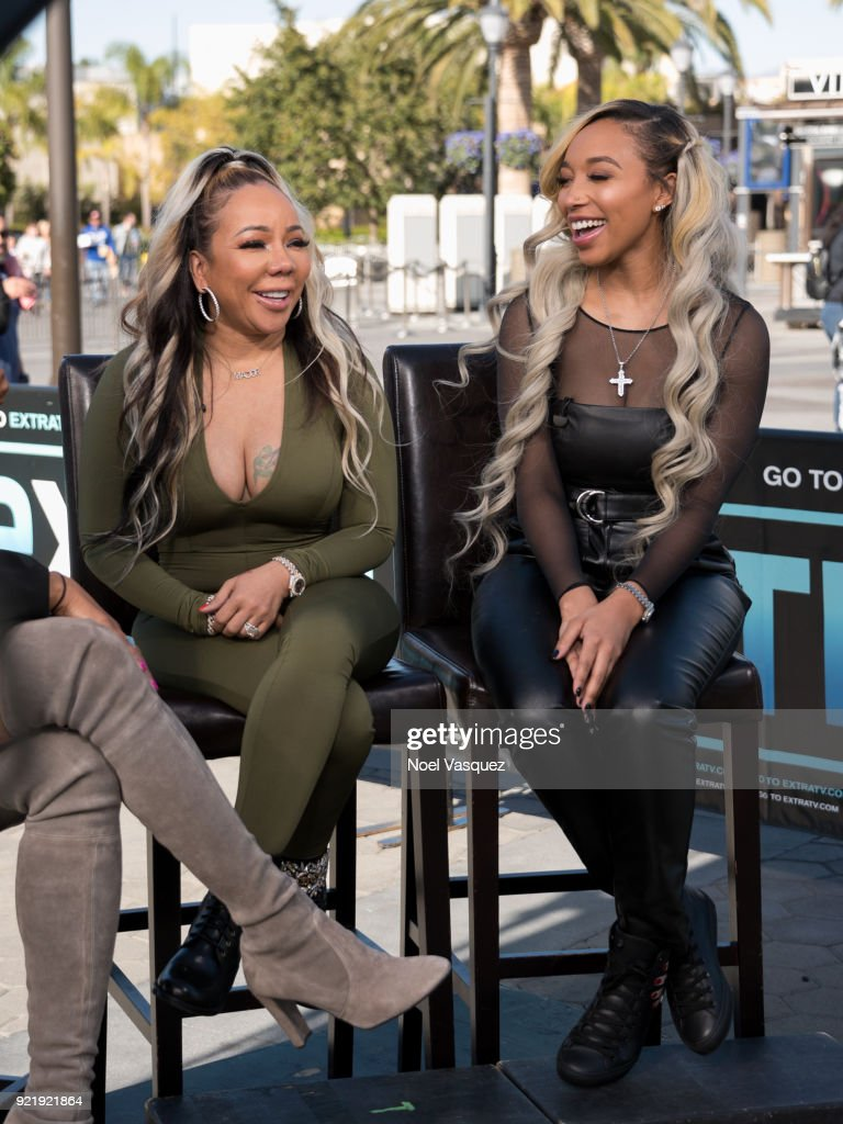 Tameka Cottle (L) and Zonnique Pullins visit 'Extra' at Universal Studios Hollywood on February 20, 2018 in Universal City, California.