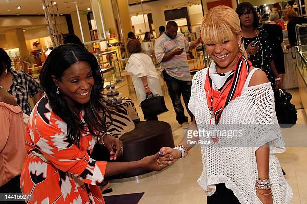 Tameka Foster and Misa Hylton attend the Simone I Smith Trunk Show at Neiman Marcus Atlanta on May 10 2012 in Atlanta Georgia
