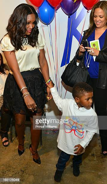 Tameka Foster and Naviyd Raymond attend the birthday and foundation lanuch Kile's World to honor Kile Glover at the Woodruff Arts Center on March 29...