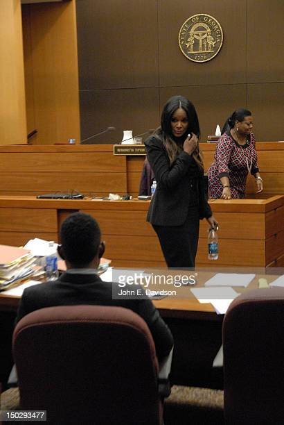 Tameka Foster attends a hearing to discuss child custody between Usher Raymond and Tameka Foster at Fulton County State Court on August 14 2012 in...
