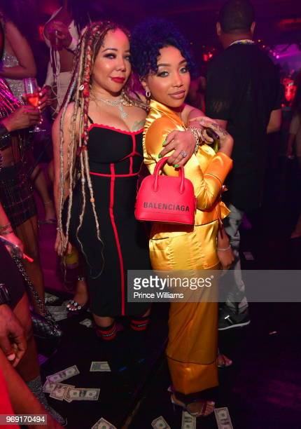 Tameka Harris and Zonnique Pullins attend a Birthday Celebration for Pierre 'Pee' Thomas at Gold Room on June 7 2018 in Atlanta Georgia