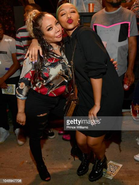Tameka Harris and Zonnique Pullins attends the Dime Trap Album release Event at The Trap Museum on October 4 2018 in Atlanta Georgia