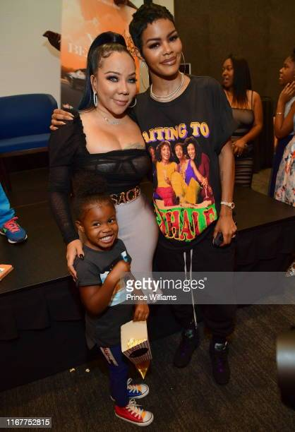Tameka Harris Teyana Taylor and Iman Tayla Shumpert Jr attend You Be There Screening at The Gathering Spot on August 11 2019 in Atlanta Georgia