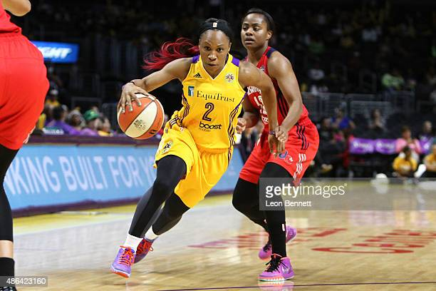 Tameka Johnson of the Los Angeles Sparks drives to the basket against Ivory Latta of the Washington Mystics in a WNBA game at Staples Center on...