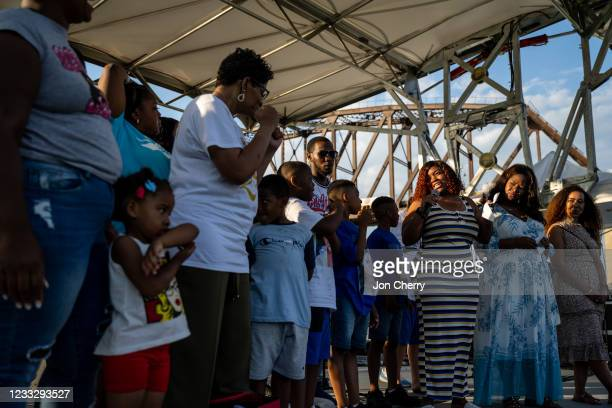 """Tameka Palmer, Breonna Taylor's mother, stands on stage with attendees during the """"Praise in the Park"""" event at the Big Four Lawn on June 5, 2021 in..."""
