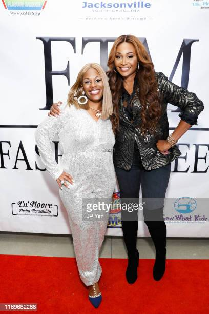 Tameka S Bright and Cynthia Bailey attend FTM Fashion Week S7 at Sturgeon City on November 23 2019 in Jacksonville North Carolina