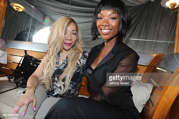 Tameka 'Tiny' CottleHarris and Brandy attend MILF Celebration Of Entertainment Mothers on February 6 2015 in Beverly Hills California